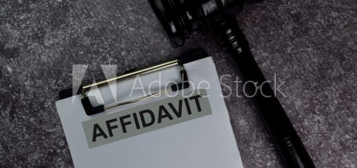 Affidavit text write on a paperwork and gavel isolated on office desk.