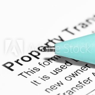 Close up shot of pencil tip showing concept of signing the property transfer document
