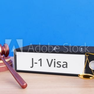J-1 Visa – Folder with labeling, gavel and libra – law, judgement, lawyer