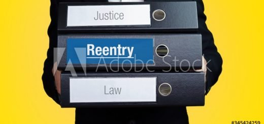 Reentry – Lawyer carries a stack of 3 file folders. One folder has the label Reentry. Symbol for law, justice, judgement